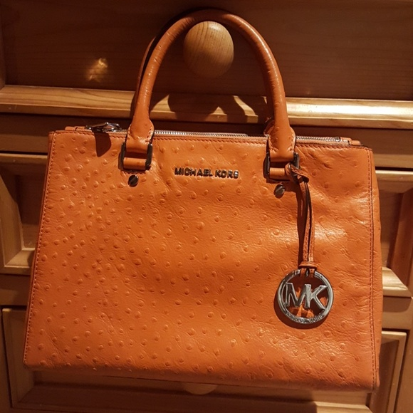 aeef7cebe46070 EUC Michael Kors gorgeous orange purse. M_5bf5fd0c7386bc47e021e83a